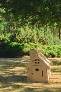 Toy house made of corrugated cardboard in the city park Stock Photos