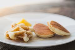 Pancakes with honey dipper Stock Photos