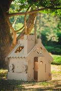 Stock Photo of Toy house made of corrugated cardboard in the city park