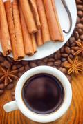 Fresh aroma coffee in the white cup, coffee and cinnamon - stock photo