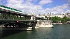 A Paris Metro train (in 4k) crossing the Pont de Bir-Hakeim. Stock Footage