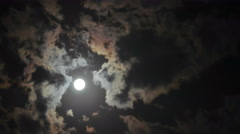 4k Timelapse with moon moving between clouds Stock Footage
