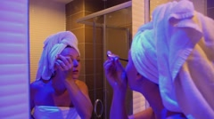 Beautiful Female Putting Mascara On in Bathroom after Shower Stock Footage