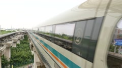 Shanghai Maglev train approach station.This train is the first commercially oper Stock Footage