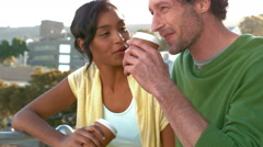 Happy business couple drinking a take-away coffee Stock Footage