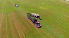 Industrial Agricultural Trucks and Machines Harvesting Crop, Aerial View Stock Footage