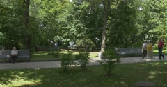 Mariyinsky Park With Its Dense Greenary, Wooden Benches and a Long Park Lane in Stock Footage