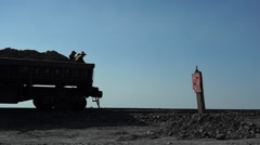 Train transporting coal, driving on the track Stock Footage