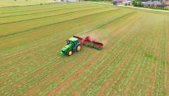 Agricultural Farm Tractor, Combine, Harvester, Harvesting Crop, Aerial View - stock footage