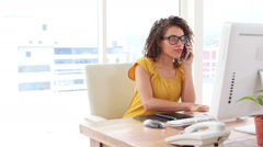 Excited businesswoman talking on the phone Stock Footage