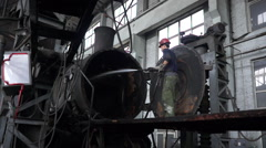 Worker cleaning steam locomotive Stock Footage