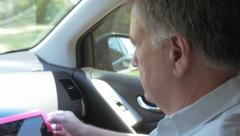 mature man staying connected with tablet pc while traveling 4k - stock footage