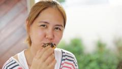 Yong asian woman eating donut sweet food - stock footage