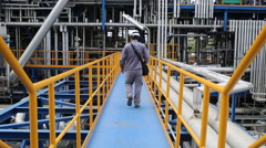 A man working in refinery plant - stock footage