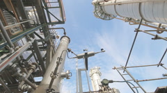 Stock Video Footage of Refining tower with blue sky