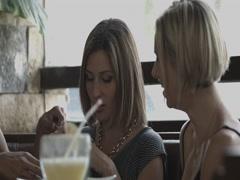 Friends sitting in restaurant Stock Footage