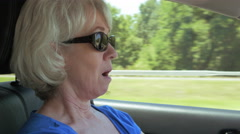 Woman showing that she is tired while driving 4k Stock Footage
