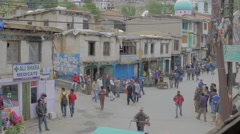 Cars and pedestrian in main bazaar,Kargil,Ladakh,India - stock footage
