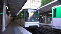 A Paris Metro train pulling in to a staion (in 4K), Paris, France. Stock Footage