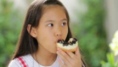 Little asian child eating donut sweet food - stock footage