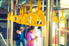 Handles passenger inside a bus.  ( Filtered image processed vintage effect. ) Stock Photos