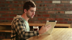 Smiling customer holding a digital tablet Stock Footage