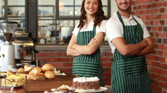 Smiling waiter and waitress gesturing thumbs up Stock Footage