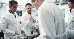 Mechanics, engineers and large jumbo jet engine turbine Arkistovideo