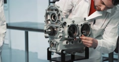 Male mechanics at a aviation engines - stock footage