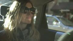 Country girl comes to town, in the car - stock footage