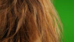 Blowing hot air with hair dryer in  front of green screen background 4K 2160p Stock Footage