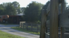 Fence post on farm in morning sunlight - stock footage
