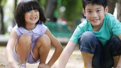 Happy Asian kids are playing sand in a park, Bangkok Thailand. Stock Footage