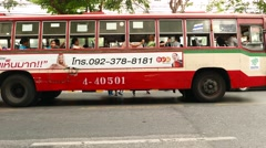Bangkok free public bus side view, vehicle move away Stock Footage