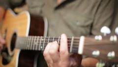 Guitar strumming in morning sunlight - stock footage