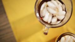 Iced tea on country farm table Stock Footage