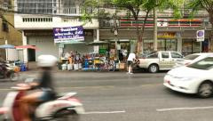 Charoen Krung Road daytime, light traffic, street vendor against grocery store Stock Footage