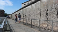 Tourists at berlin wall taking selfies Stock Footage