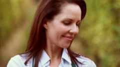 Brunette winegrower tidying the red grapes in the basket Stock Footage
