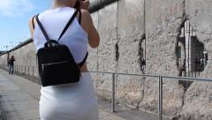 girls taking pictures of berlin wall, germany - stock footage