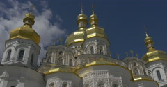 Down up Shot of Splendid Golden Domes of Uspensky Sobor and Old White Walls Stock Footage