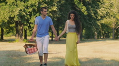 Couple on picnic, outdoor. Walking hand in hand Stock Footage