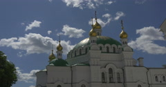 Uspensky Sobor With Its High White Walls, Half Round Windows, Golden Domes and Stock Footage
