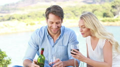 Happy couple toasting and drinking red wine - stock footage
