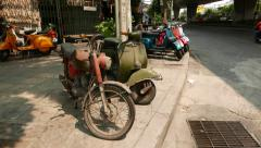 Very old motorcycle exposed for sale on the sunny street pavement Stock Footage