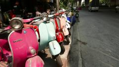 Classic Vespa motor scooters second hand sale at Bangkok street, glide shot Stock Footage