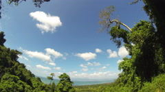 Tropical countryside view with clouds running through blue sky. 4K time lapse. - stock footage