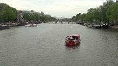 Boats in Amstel River with Magere Brug Stock Footage