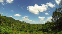 Tropical countryside view with temple in background and clouds. 4K Stock Footage