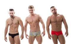 Photo of three sexy macho with bare torsos Stock Photos